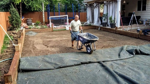 Lawn Pros staff placing the fill
