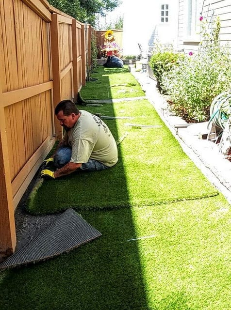 On of Lawn Pros Staff doing Grass Installation