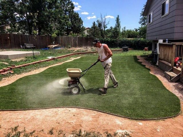 Staff doing final Artificial Grass Installation