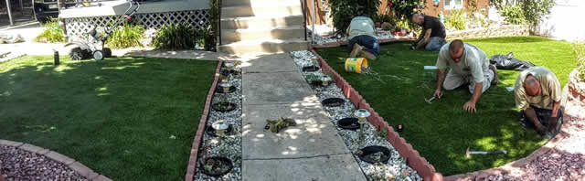Staff Doing Fake Grass Installation